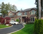 Cresmark Custom Brick Home with U-Shaped Driveway